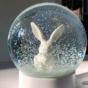 INDIGO rabbit snow globe
